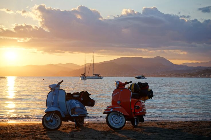 Vespa and Crapbretta on the beach in Tuscany