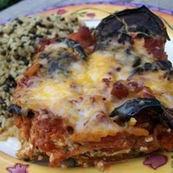 Wonderful directions for preparing eggplant if you've never done it before.  The eggplant is layered in a large pan with marinara sauce, mozzarella, ricotta and Parmesan cheese. This it 's baked until the cheese topping is golden.