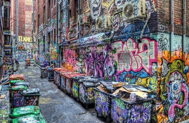 This is Rutledge Lane, off hosier lane, Fitzroy, Victoria, Australia. One of the many areas in Melbourne where graffiti is legal.