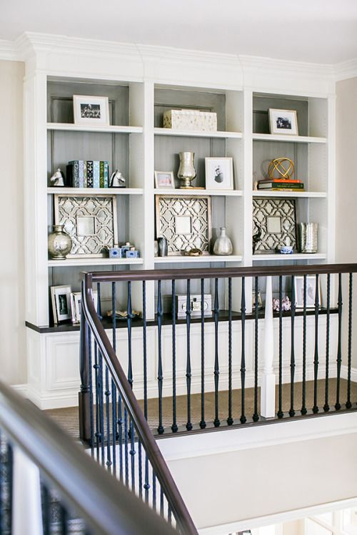 built-in shelves at top of stairs