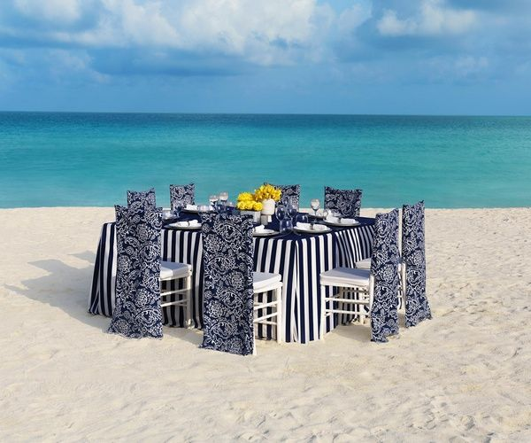 Navy and white table setting for outdoor beach wedding reception | Nautical Collection at Palace Resorts #destinationwedding