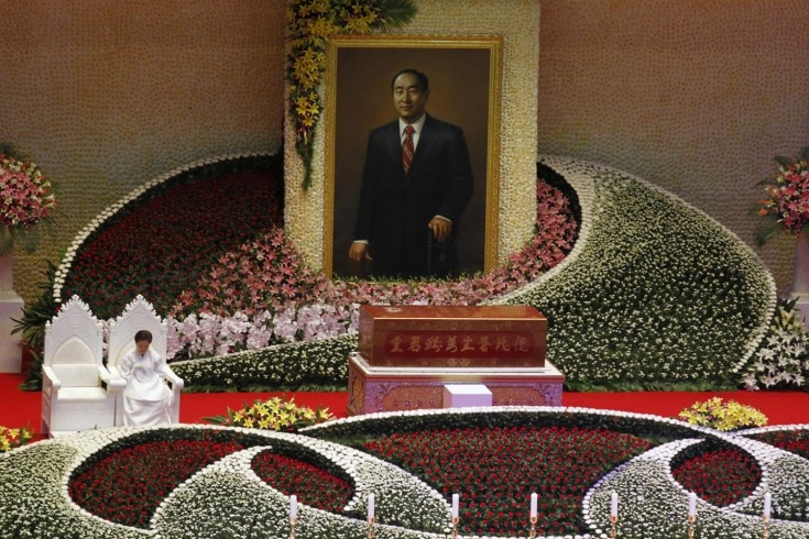 Sept. 15, 2012. Han Hak-ja, widow of Evangelist Reverend Sun-Myung Moon, sits beside the coffin of Moon during a funeral service in Gapyeong, South Korea.