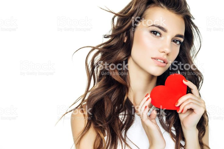 Beautiful woman holding artificial heart Стоковые фото Стоковая фотография