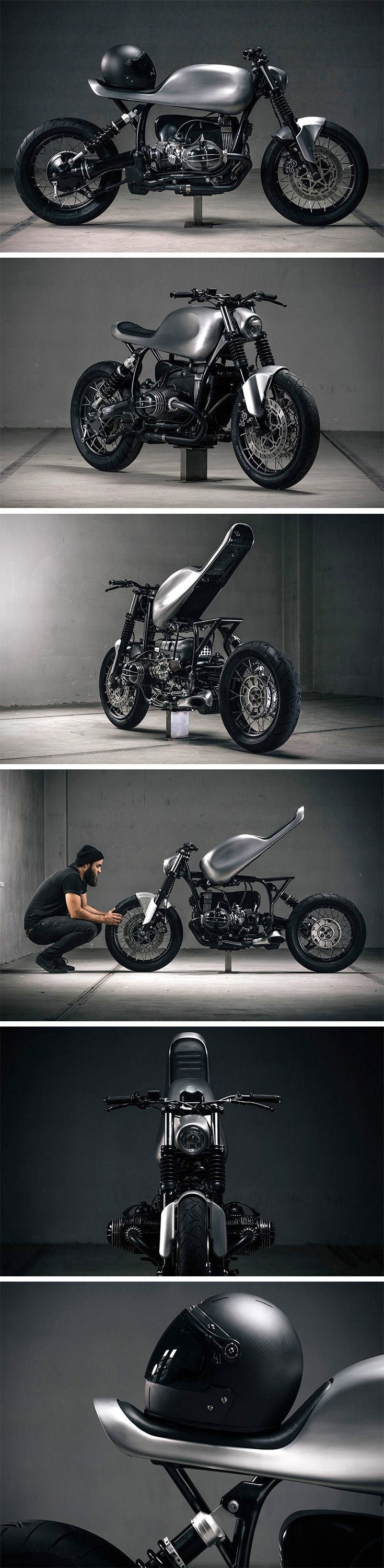 This is a custom BMW R100R cafe racer build by Paul Brauchart and Philipp Rabl of Austria-based Vagabund Moto. The stripped-down, streamlined design also sports near seamless seat integration to the tank with a built-in taillight, a matching front mudguard and headlight shell, minimalist Motogadget turn signals, and sleek black powder-coated rims.