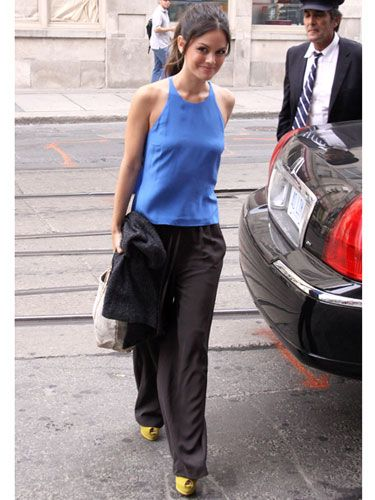 Rachel Bilson in Bright Blue with Black Flowy Pants and Yellow shoes.