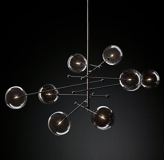 "RH Modern's Glass Globe Mobile  8-Arm Chandelier 79"":Delicate, handblown glass globes float like orbs at the ends of solid brass rods in our collection by designers Rudi Nijssen and Dominique Sente. Crafted in Poland by master glassmakers, each fixture conveys fluidity and motion yet is anchored in the pure modern architecture of its form.SHOP THE ENTIRE COLLECTION ▸"