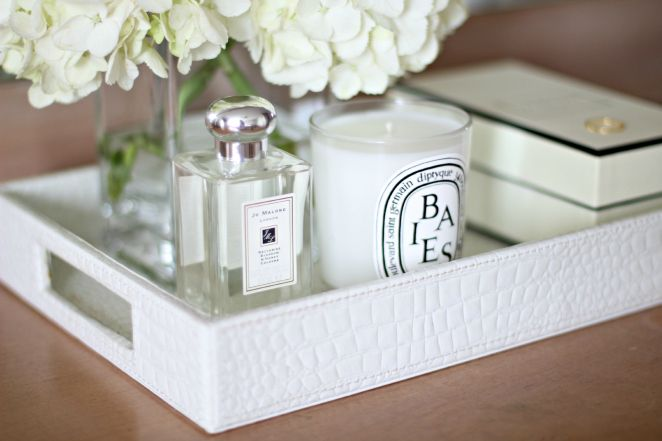 white faux croc (aligator) tray filled with white flowers jo Malone and diptyque candles