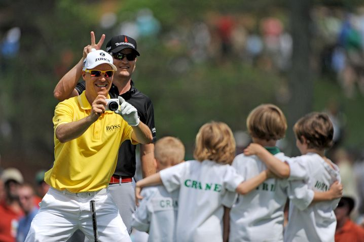 Ben Crane snapping pics of the Caddies during the Par 3 contest on Wednesday at The Masters. Zach Johnson provides the rabbit ears while Jonathan Byrd continued walking.