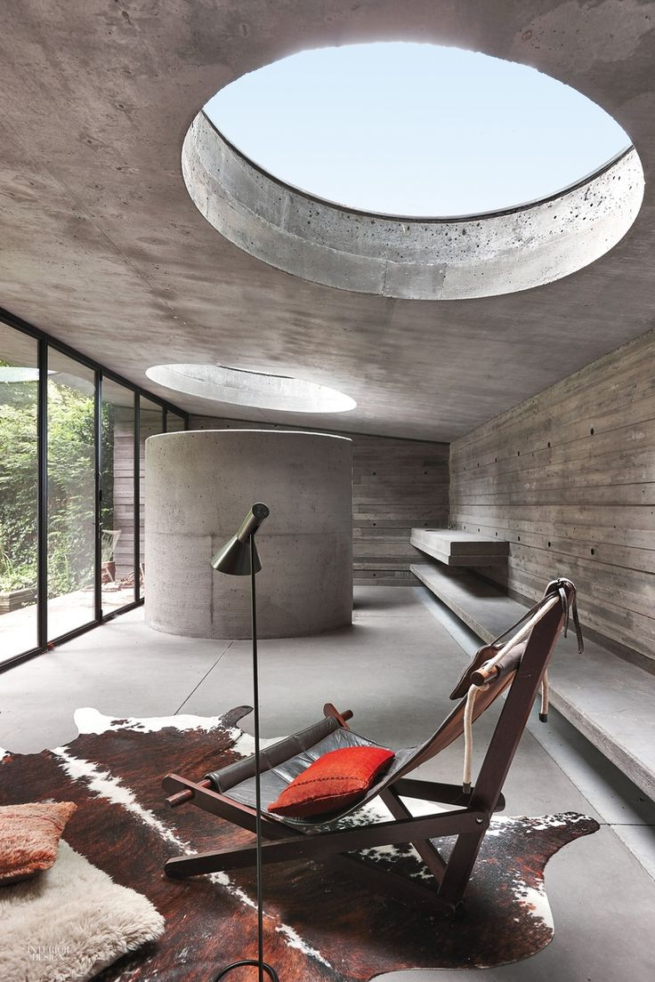 B-Architecten Draws on Modernist Archetypes for Remodel of 1930's Belgian House. A Danish chaise faces the enclosure for the guesthouse's bathroom. Photography by Jan Verlinde.
