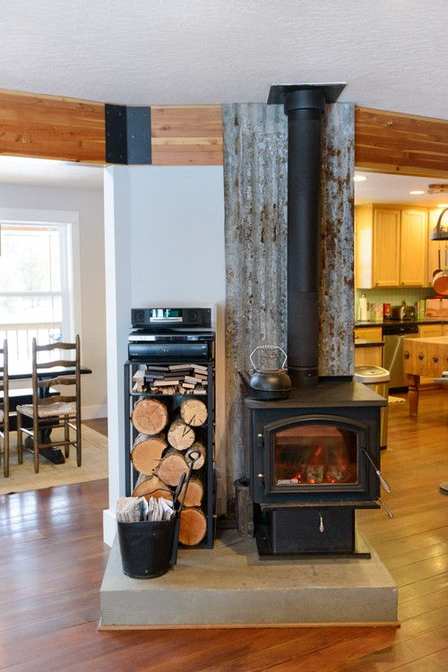 Appealing Wood Stove Installation Ideas For Any Room In The Home : Wood Stove Which Installed Based On Industry Standards With A Certain Distance From The Wall And Stove Pipe Is Double Walled With Metal Tin And Iron Behind Stove