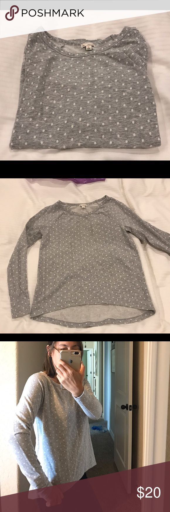 Gap Polka Dot Sweatshirt Gap lightweight sweatshirt in a sweet polka dot pattern. Light gray background with white polka dots. Size small. High-low hem line to give coverage in the rear. Great with a pair of fleece leggings. Excellent condition. GAP Tops Sweatshirts & Hoodies
