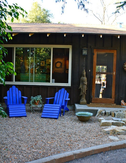 These bright blue lounging Adirondaks are the focal points of this simple, neutral yard. The paint color is Benjamin Moores Scandinavian Blue.