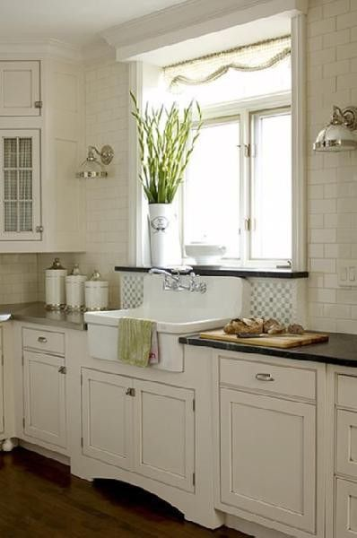 Love so much about this - the sink, especially, and the subway tiles, the backsplash, the pair of lights, the black granite counters, and the cutout at the bottom of the cabinet so you can stand closer to the sink.