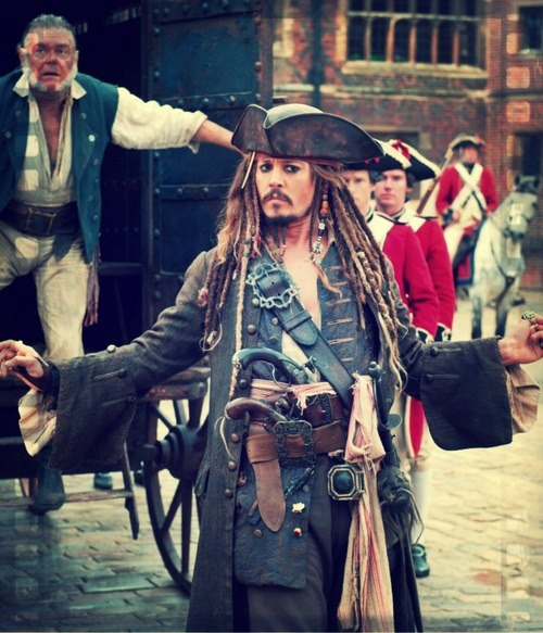 Jack Sparrow - That guyliner. That perennially half-drunk, forearm-extended manner of walking and speaking. The overall swagger. Love. ;)