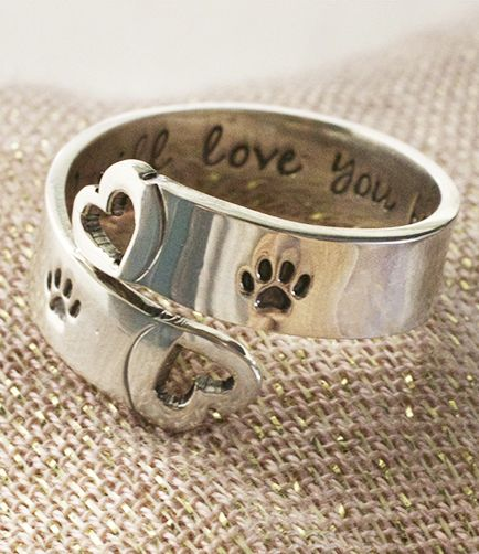 """Carry the love you have for your pet in your heart, and on your jewelry. Our sterling silver adjustable ring is accented with two paw prints, along with the words """"I will love you forever"""" on the inside."""
