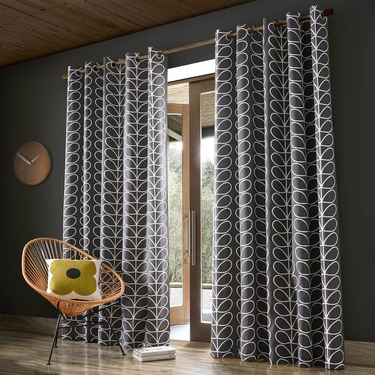 Transform an interior setting with this pair of Linear Stem curtains from Orla Kiely. Effortlessly sophisticated the charcoal grey surface is adorned with a cream linear stem print, introducing the br