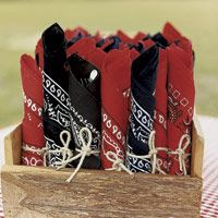 Exactly what I am envisioning!  Bandanna Wrapped Silverware tied with twine.  Several other chuck-wagon party ideas on the link.