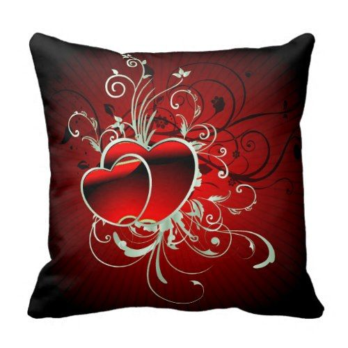 Red Scroll Hearts Pillow Decorating Your Home Decor with Red Throw Pillows Do you love a livened up living room? Do you like unique yet striking colors for office seat? Red throw pillows complements well with other home decor, offers elegance and style in the office and comes in a variety of shapes and sizes as well.