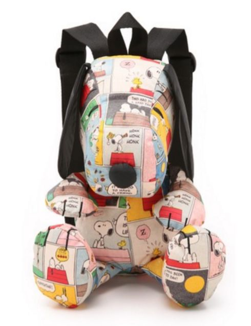 A Snoopy covered with his own colorful comics.