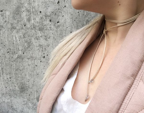 Wrap and style this choker however you like. The suede nude choker is 47 inches long. The ends are detailed with gold metal and triple faceted quartz stones wrapped with gold brass wire.