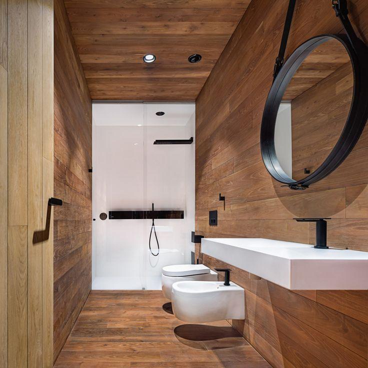A wood, white and black bathroom