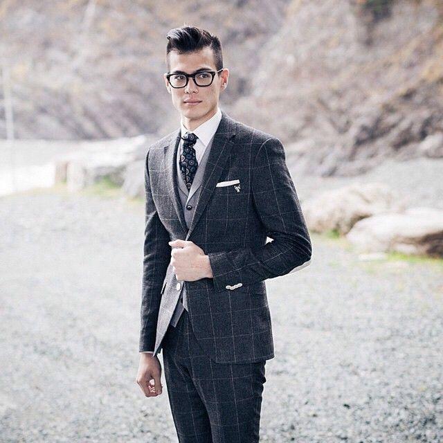 Charcoal tartan blazer & slacks, light grey vest, tri-grey multicircular tie, white shirt & kerchief