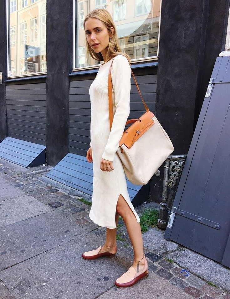 An easy, clean and effortless look–a cream dress from Ganni, vintage bag from Hermès, and slides from The Row