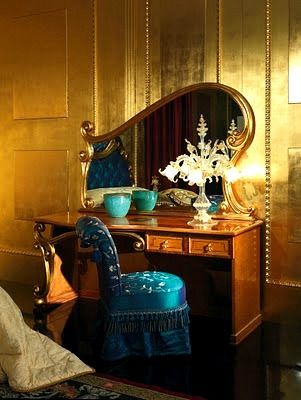 Art Nouveau dressing table with Peacock Blue satin fringed vanity chair.