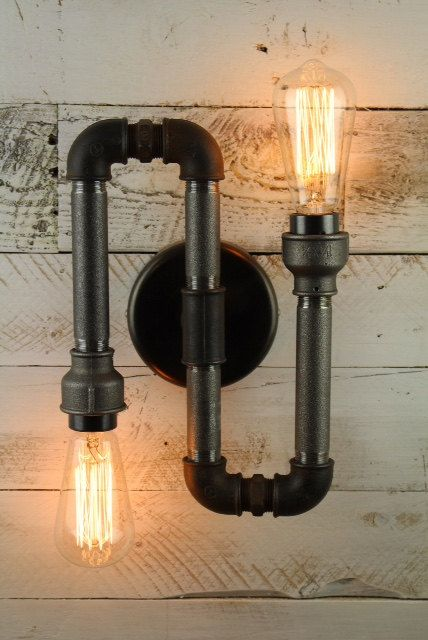 Bespoke and individual design SteamPunk Vintage/Retro Wall Light. This wall light has two Edison Screw E27 fittings and mounts to wall on a 120 mm dia wall plate. This light fitting is for indoor use only Alternative designs are available on request. The Edison bulbs shown in the