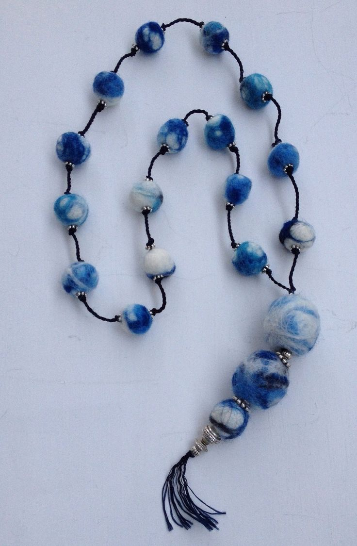 Hot water felted beads made to look like blue and white China beads.