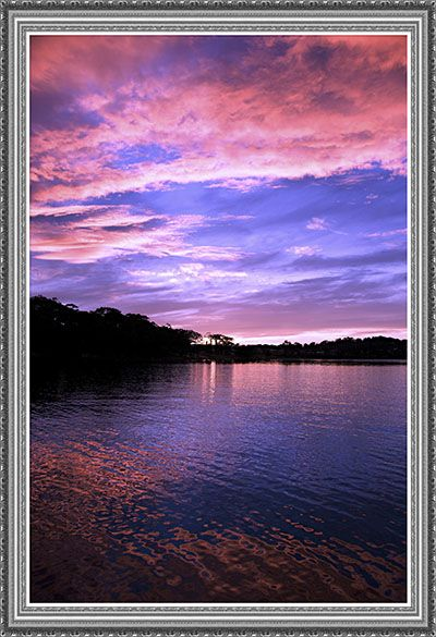 Vivid coloured Seascape Sunrise with beautiful pink clouds and water reflections. Photographed at Lake Macquarie, New South Wales, Australia To see all High Resolution sizes and download products for this image.. Please Visit....http://www.sunnypicsoz.com/ for you to enjoy !!!...