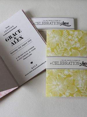 Wedding invitation books featuring vintage inspired type & print.