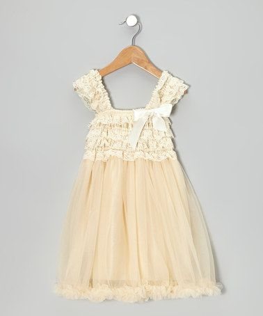 This Ivory Ruffle Babydoll Dress - Toddler & Girls is perfect! #zulilyfinds