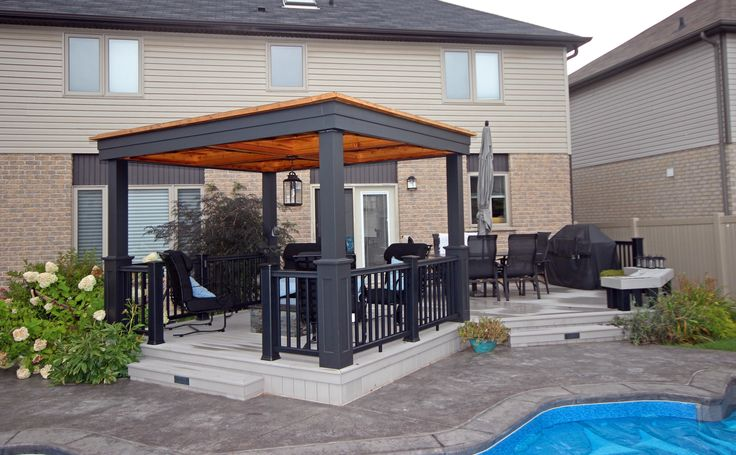 This low maintenance deck uses Clubhouse vinyl decking and was built by Hickory Dickory Decks in Kitchener Ontario.