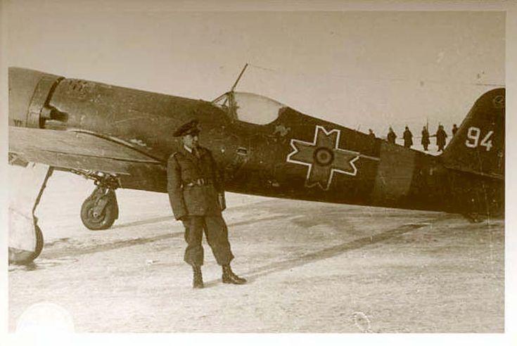 """""""Hero shot"""" of an IAR-80 pilot with his aircraft"""