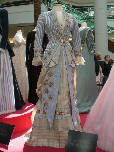 Oliva  The Prestige  Jacket of satin striped voile. Striped silk twill skirt with pleated gauze with ribbon trim and applied embroidery. Lapels, cuffs, bodice facing, and front skirt panels are silk overlaid with lace and applied floral embroidery. The Costumer's Guide to Movie Costumes