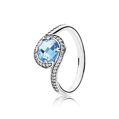 Amp up your style with this dramatic, radiant blue ring. Gently curved lines set with shimmering stones add further sophistication to the design, which has a timeless yet contemporary expression. #PANDORA #PANDORAring