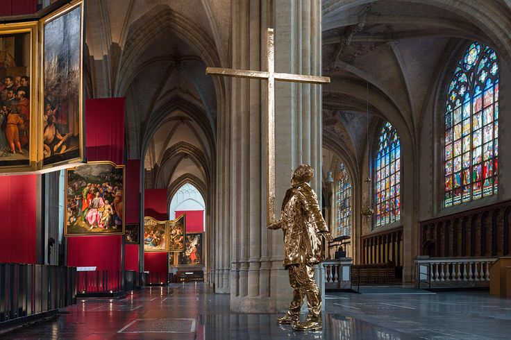 """[Jan Fabre] The man who bears the cross, 2015 - """"I think the sculpture reflects my identity as an artist, as a human, as someone who is searching, doubting, taking risks, choosing to experiment, asking questions"""", he reveals in our conversation on the day of the artwork's official inauguration. """"When you look at my oeuvre, the cross is always there, and it is very important for different reasons. Don't forget, when you think about visual arts purely, but also socially, you think about the…"""
