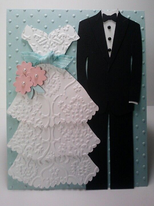 The bride & groom. Bride made from Cricut Artiste cartridge. Groom made with free template from karenburniston.com I made this for a friend's wedding.