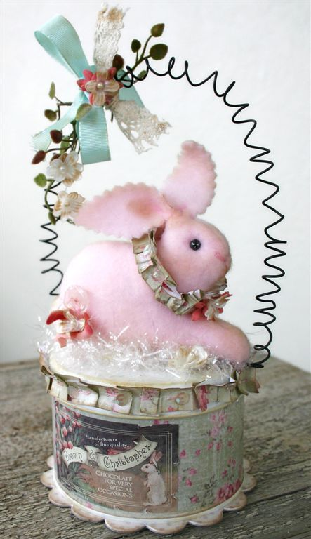 Here comes Peter Cottontail...I like the tin basket and wire handle. C.