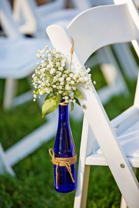 baby's breath in blue glass beer bottle / http://www.deerpearlflowers.com/wine-bottle-vineyard-wedding-decor-ideas/