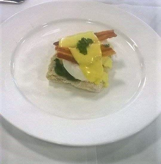Eggs benedict on a soft irish blaa made in Waterford, hollandaise sauce, crispy bacon garnished with parsley