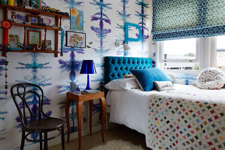 """[i]Upstairs in Caroline's daughter's bedroom, 'Vertical Stripe' [link url=""""http://www.houseandgarden.co.uk/interiors/wallpaper""""]wallpaper[/link] from [link url=""""http://www.timorousbeasties.com/""""]Timorous Beasties[/link] lines the walls, adding to the fun blue-and-white scheme.[/i]  Like this? Then you'll love  [link url=""""http://www.houseandgarden.co.uk/interiors/kids-rooms""""]Kids' Rooms[/link]"""