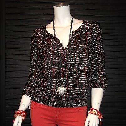 Nieuwe top zwart met oranje en paars motief 39,95. Oranje jeans 39,95