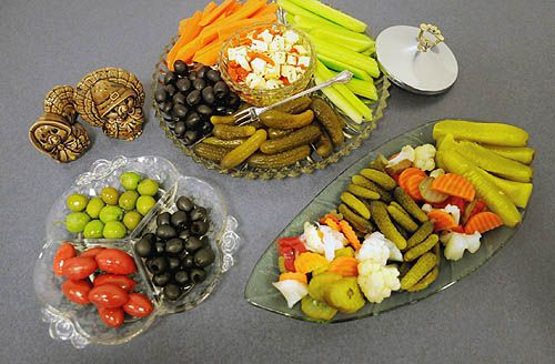 I think I'm going to go with an assortment of smaller relish trays, full of fresh items to balance out the rich food...
