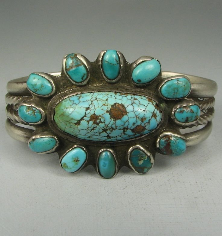 It has a gorgeous oval high domed spiderwebbed natural turquoise stone at center, surrounded by 12 oval old-style high bezel set stones, the outer edge stones having some outer bezel loss from wear, all in great shape, tight, and posing no problem, set onto a scalloped ingot silver plate. | eBay!