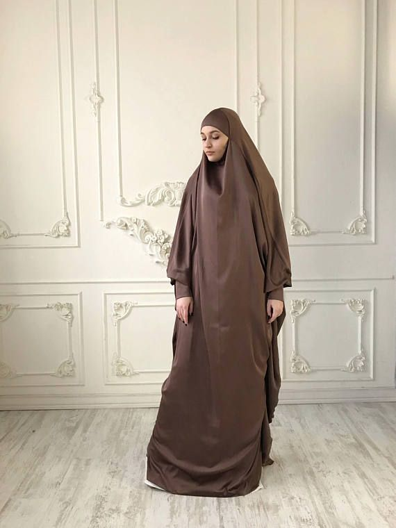 Light brown silk long khimar with high cuffs. This jilbab will be a good cover for you. Delicate fine silk ideal for summer weather. Always keep in mind that the fabric is enlightened, at the bottom have to be the dress. An elegant way for the believing women. Buttons secure the