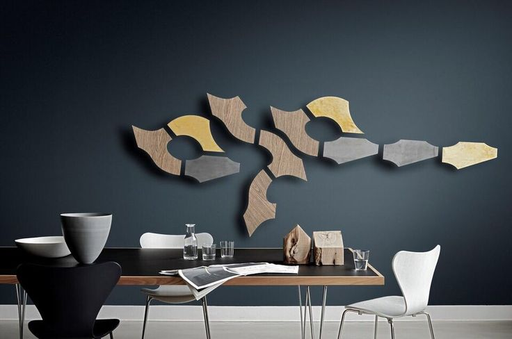 An adorned combination of our smaller sculptures into one large sculpture. Here in an exclusive meeting room setting. XOX, Yin and Zeppelin sculptures in oak, brass and zinc. Play with the single sculptures and create your very own piece of art.