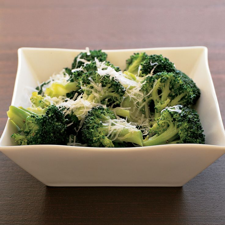 Boiled broccoli is enlivened by shredded Parmesan cheese and a hint of butter.