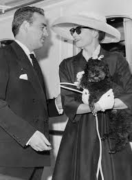 Grace Kelly and Oliver the poodle arrive in Monaco.